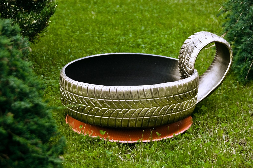 This used auto tire flower planter will make your shop SPRING into spring